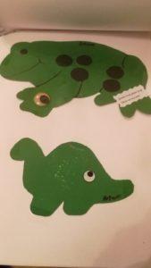 Rana y dinosaurio con ojos en las patas.